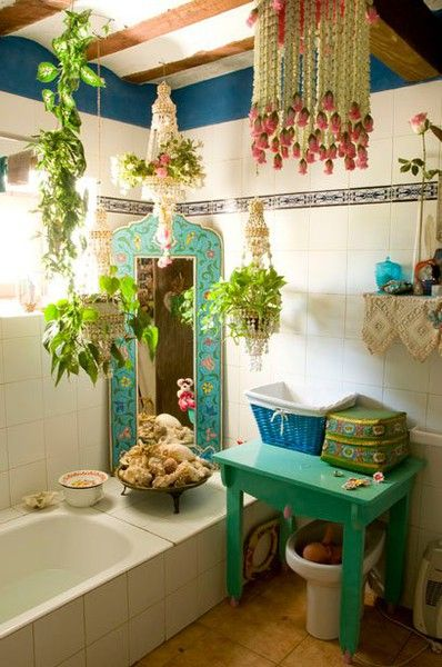 This colourful  white and turquoise bath features lots of living greenery  and quaint details. Romantic Boho Bathroom   StyleSaVie