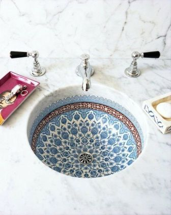 I fell in love with tiled sinks on our trip to Spain. Our villa in Altea's hills had a gorgeous deep blue and white sink, with mosaics. Found on apartmenttherapy.com
