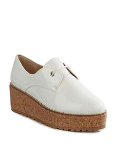 Shellys of London has it going on with this white patent flatform. Long, long legs with a boyish twist, perfect with culottes, skirts or cropped trousers. And the cork bottom is soft on your feet for a day full of walking.