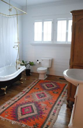 Charm and character in the warmth and texture of an area rug, wood floors and antiques. Found on thecurtiscasa.com