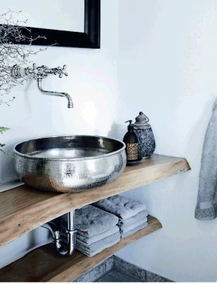 Hammered metal, fancy hipster handsoap, live edge wooden shelves and more texture than you can shake a stick at. Love. Found on planete-deco.fr