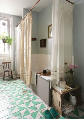 Beautiful drapes as shower curtains and a painted floor - imperfectly perfect. Found on introducingnewworlds.blogspot.com