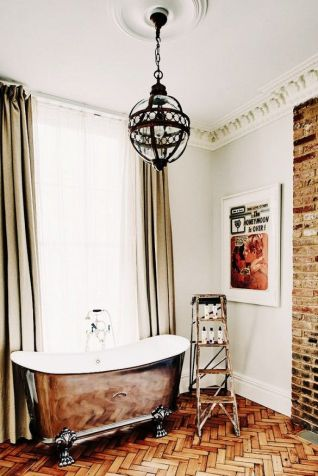 This luxe w/c includes floor to ceiling touches of vintage style, but manages to look thoroughly 'now.' From the crown moulding, heavy drapes, brick and lighting, to the gorgeous tub and old step ladder, this is a perfect marriage of old combined in a new way. Photo: Tour London's Most Lust-Worthy New Boutique Hotel via @Domaine