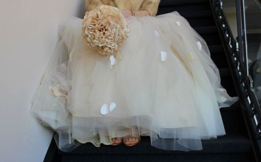 My tulle-skirted, one shoulder gown, in blush, with a paper bouquet and Granny's vintage fur.