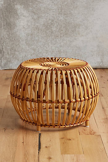 Anthro's Susila Rattan Ottoman $198.00, is pretty and practical, but not significantly MORE so than the Ikea collaboration designs.
