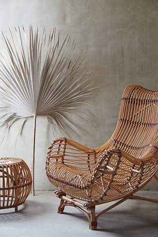Styled to perfection. Who wouldn't want to recline in a Susila Rattan Chair for  $998.00 (Anthro)