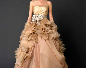 This dress has a very theatrical flare that reminds me of ballet costumes... and actually resembles quite closely the dress I ended up purchasing. Strapless tulle and organza princess wedding dress. Lemandywedding.
