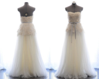 Seeing some similarities emerging: off-white, soft skirts and layers, sweetheart necks, bare shoulder(s) and back, waist details... Custom Wedding Gown- Summer Sunshine-Alencon lace and tulle A-line floor length wedding dress-made to order: $2,253.38 CAD TingBridal