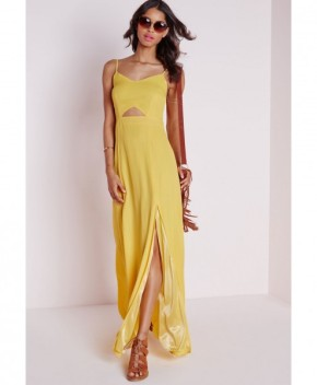 Keeping with the sunny palette, this dress is high drama, low fuss. You are covered, with just a touch of skin showing for a look that can be amped-up for evening with a change of shoe and makeup.
