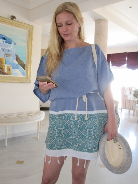 The day after the wedding; the bride, Lindsay, was ready to relax on the beach. Tunic/beach coverup from Muska - Thira, Santorini.