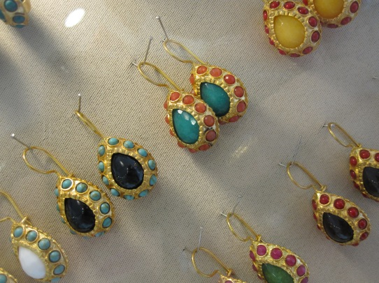 Gems set in ornate teardrop settings, in a rainbow of colours. I love the turquoise and coral with gold.