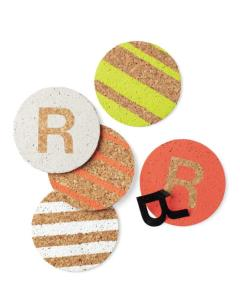 Some fun coasters to protect her house from your clumsiness. Perhaps some Tide-to-Go, too.